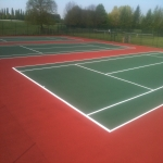 Line Marking Tennis Pitches in Ab Lench 1